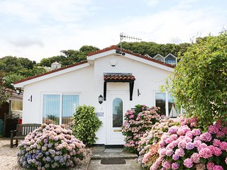 PHOENIX COTTAGE, detached bungalow, conversatory, enclosed courtyard, sea views,