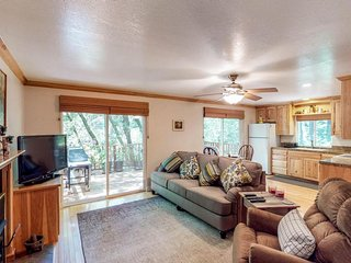 Lovely home with wood fireplace, large deck w/ grill, and surrounded by forest