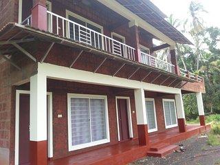 kannur west beach house, Homestay