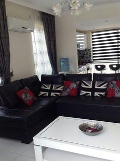 living area with fantastic views from all angles. including TV, DVD player, WII and WIFI.