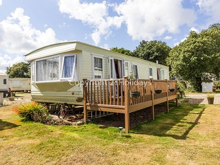 6 berth caravan with decking and part sea view. At Azure Sea Holiday Park. 32042