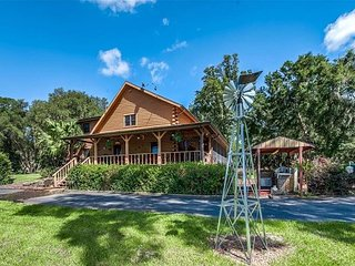 Rustic Cabin Home, Waterfront Lake Blanton Retreat with Pool, Horse Stable