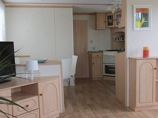 6 Berth with decking near amenities at Steeple Bay Holiday Park. REF 36072D