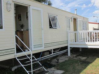 6 berth caravan with decking, near amenities at Steeple Bay Resort. REF 36072D