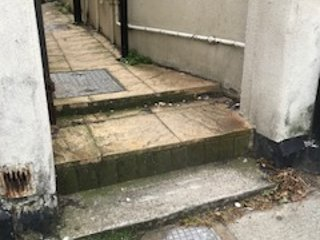 Steps up to passageway - otherwise all on one level