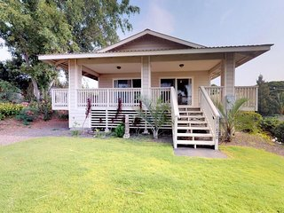NEW LISTING! Breezy, updated home w/lanai & ocean view - walk to golf course