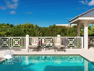 Gumbo Cottage is a Caribbean Styled 3BR Villa steps from Grace Bay Beach