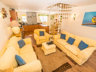 The living area is open plan with a large smart TV. The sofas can sit 6 people.