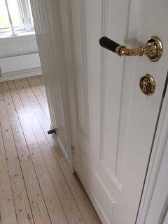 Hallway (bathroom door on right).