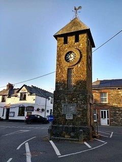 Saint Teath Village (foreground) clock & Pub (background)
