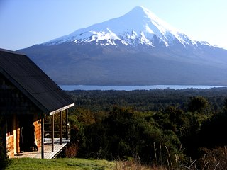 Peaceful countryside perch with panoramic view of volcanoes, forests, and lake