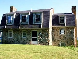 Beautiful stone 1Br/1Ba beachfront home, with balcony & cozy brick fireplace