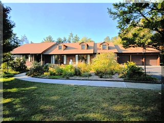 Classic design ranch on a private 10 acre wooded lot surrounded by town forest