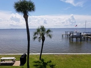 NEW LISTING! Waterfront condo w/shared dock, views, walking distance to beach!