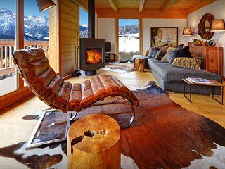 Cosy sofas and crackling fire at this 4* chalet near village - OVO Network