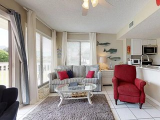 NEW LISTING! Ground-floor, waterfront condo w/shared pool, hot tub- beach nearby
