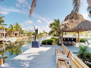 NEW LISTING! Waterfront home on canal with  dock, Tiki hut & amazing water views