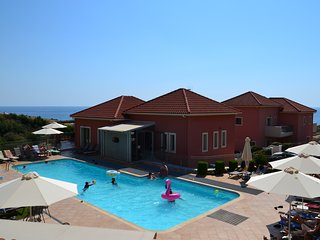 Sea view 2 bedroom apartments Skala, Kefalonia: green lawn, swimming pool, bar