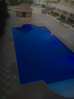 Pool at Dusk from front door of property