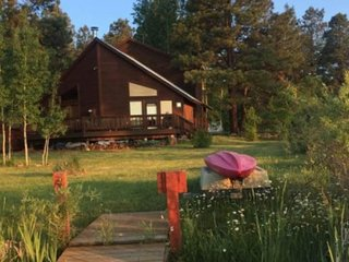 NEW LISTING! Waterfront cabin w/lake & mountain view, furnished deck & dock