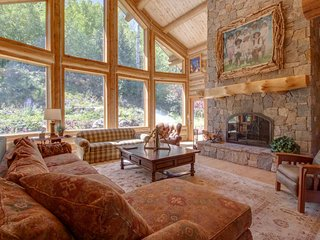 NEW LISTING! Spacious log home w/fireplace, near town, yet remote on 71 acres