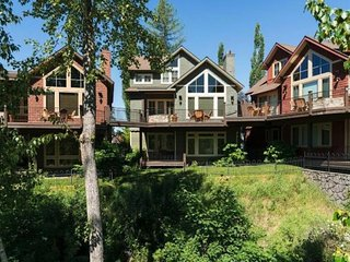 NEW LISTING! Upper level waterfront condo w/ fire pit & view of Swan River