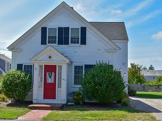 Beautifully renovated five bedroom home boasting Cape Cod charm