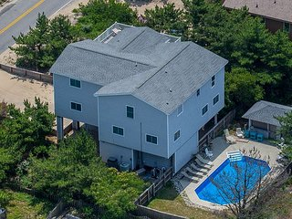 Just a few steps from the beach.Private Pool and cabana! NEW LISTING
