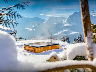 Admire the view from the hot tub at this 4* Alpine ski chalet - OVO Network
