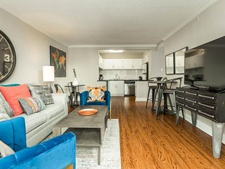 NEW LISTING! Spacious high-rise apartment w/shared pool in the heart of downtown
