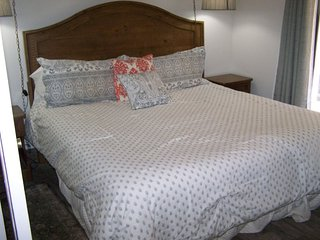 This family suite 210 offers a set of bunk beds in addition to the king bed in t