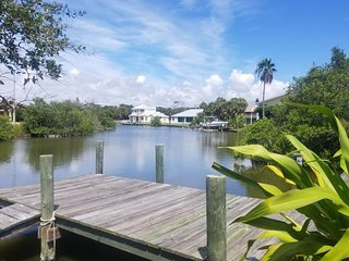 Riverfront home w/ patio, dock, 2 kayaks & shared pool/tennis - walk to beach!
