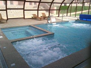 Superbe appartement dans un complexe privé avec SPA, jacuzzis , sauna, piscines