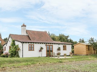 LITTLE POUND HOUSE, woodburner, beams, in Mamble