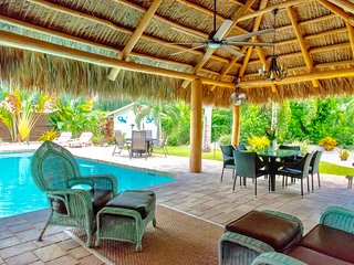 Beautiful Tiki Home with large pool, kayaks, bikes.  Great Location