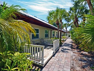 Hidden Paradise Among Tropical Landscape on Lakefront Property on Siesta Key