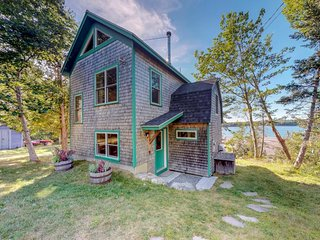 Bright shorefront home with river views, kayaks, woodstove, and more!