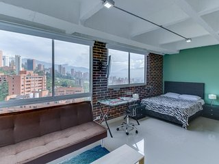 NEW LISTING! Modern studio with sweeping city views - dogs welcome