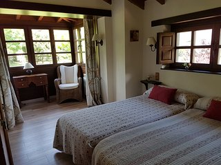 Dormitorio dos camas.