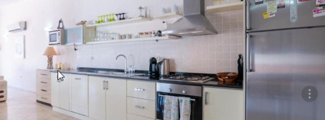 A very well equipped kitchen with gas stove, electric oven and microwave
