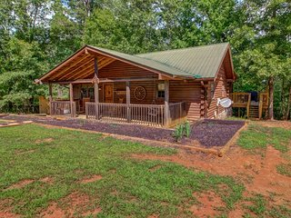 NEW LISTING! Lakefront woodland cabin w/hot tub, sauna & porches - 2 dogs OK