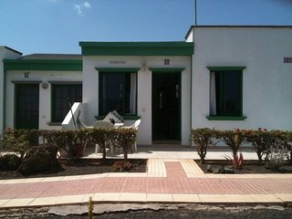 Lovely bungalow in secure and quiet complex in front of pool with ocean views.
