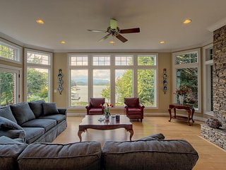 NEW LISTING! Stunning lakefront estate on one acre with private dock, WiFi