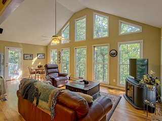 NEW LISTING! Secluded woodland home w/ a shared pool, fireplace, two decks