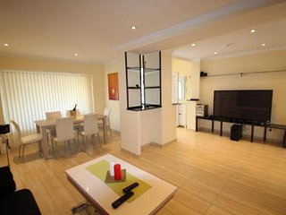 Modern 3 bedroom house with community pool and WiFi.