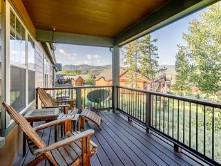 Main level deck with Adirondack seating and slope views