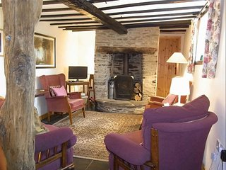 Living room with log burner, sofa and three easy chairs