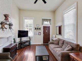 Living room looking at front door.  Queen sleeper sofa, cable HDTV.