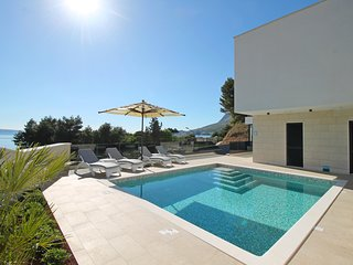 Luxury, seafront  Villa Petra with heated pool only 50m from beach