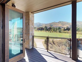 Luxury condo with large deck, shared pool and hot tub, walk to ski access!